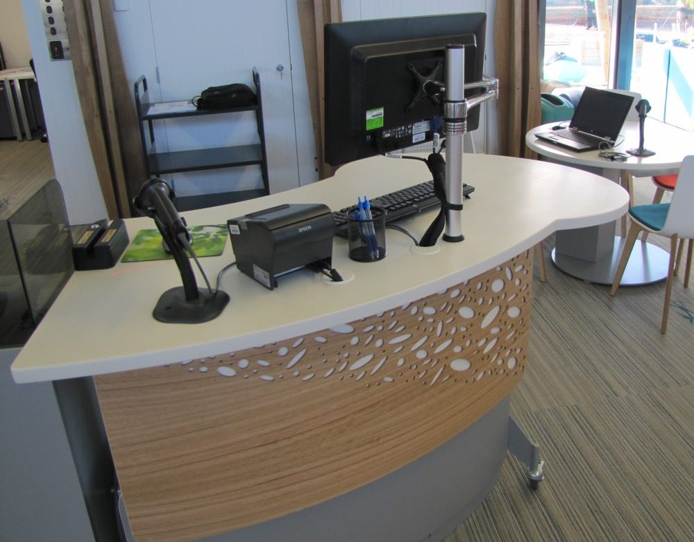 Height adjustable GLO 1600 with its interactive worktop and a customised lattice pattern frontage.