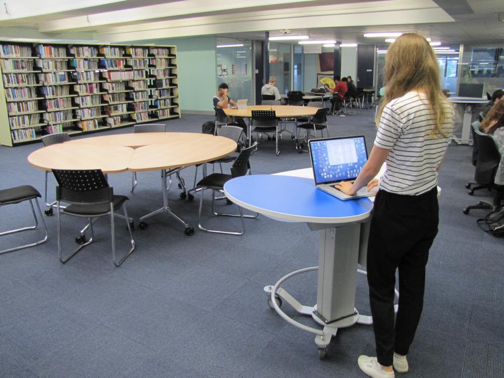 GLO MINI positioned as a help station at The University of Auckland General Library.