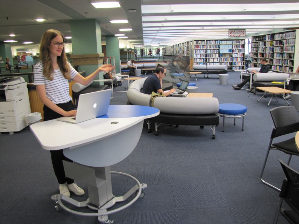 GLO MINI - a height adjustable teaching / help / roaming station, being demonstrated as a teaching station at The University of Auckland General Library.