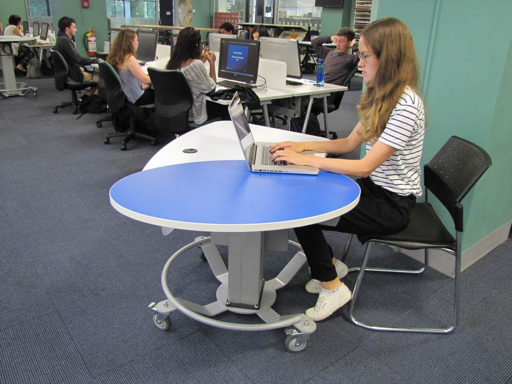 Height adjustable GLO MINI in the seated position.
