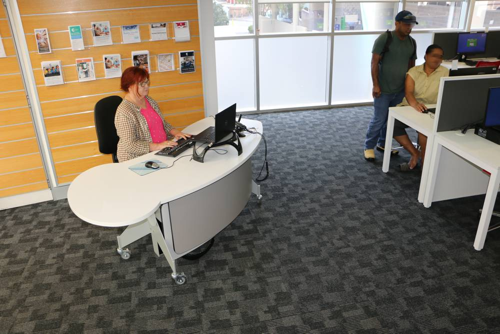 GLO 2000 Single Oval in the seated position, becomes a help desk in a public computer area, at Cumberland City Council's Auburn library.