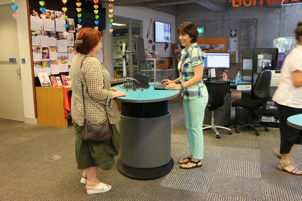 YAKETY YAK's oval worktop facilitates a friendly exchange, at Mona Vale Library, Northern Beaches.