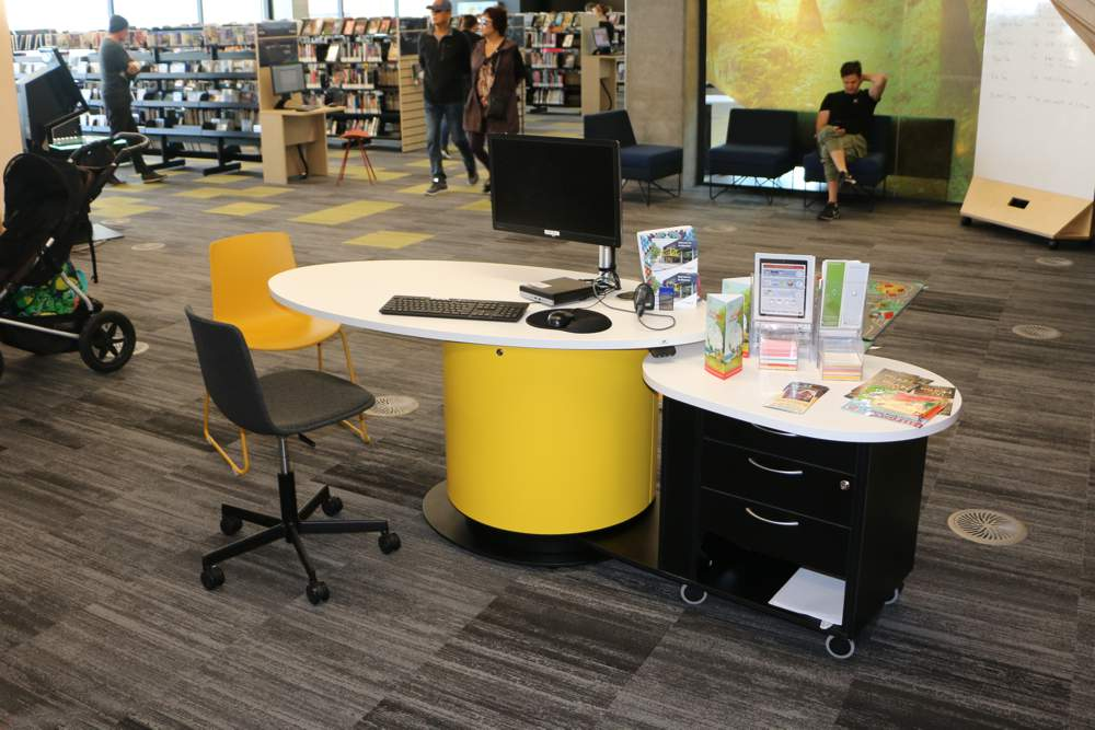 YAKETY YAK Nova Oval 1600 pod (in the seated position) teamed with YAKETY YAK Support Caddy, positioned in the heart of the library.