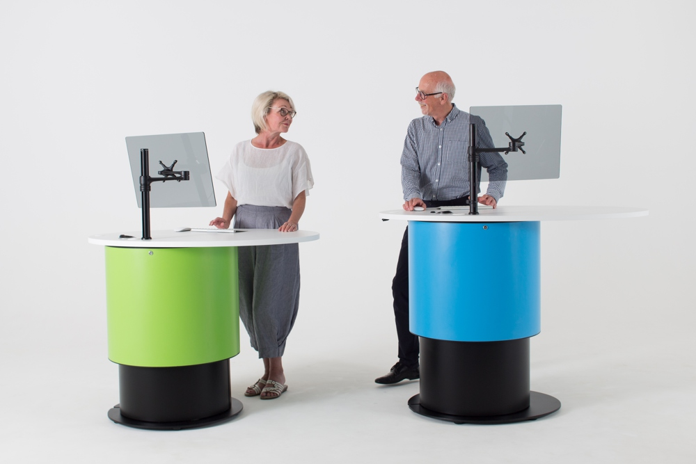 Height adjustable YAKETY YAK Nova Oval 1400 desk allows staff to work ergonomically at seated or standing height.